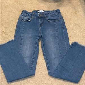 DKNY jeans with raw hem, hit above ankle.